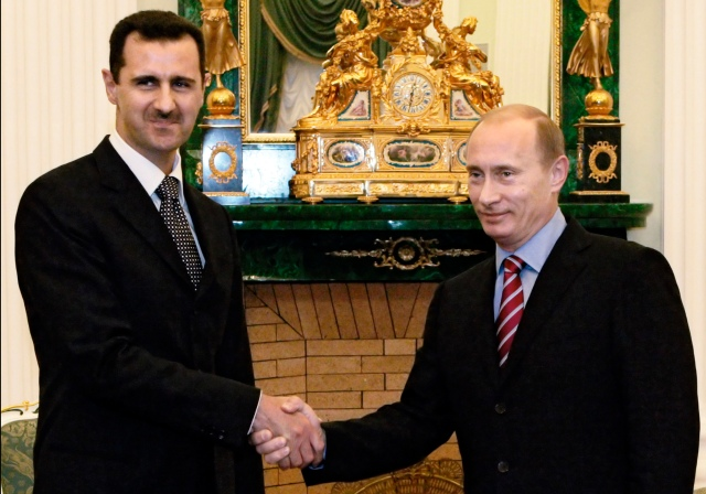 Vladimir Putin meets with Bashar Assad in Moscow's Kremlin.