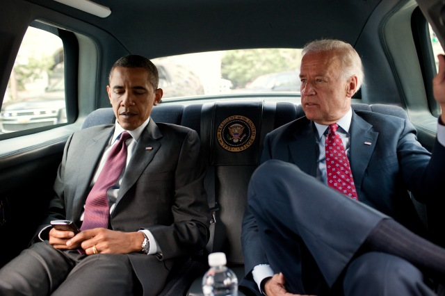 President Barack Obama and Vice President Joe Biden ride in the motorcade from the White House to the Ronald Reagan Building in Washington, D.C., July 21, 2010, to sign the Dodd-Frank Wall Street Reform and Consumer Protection Act. (Official White House Photo by Pete Souza) This official White House photograph is being made available only for publication by news organizations and/or for personal use printing by the subject(s) of the photograph. The photograph may not be manipulated in any way and may not be used in commercial or political materials, advertisements, emails, products, promotions that in any way suggests approval or endorsement of the President, the First Family, or the White House.