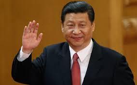 Kinas ledare säger hej till publiken!